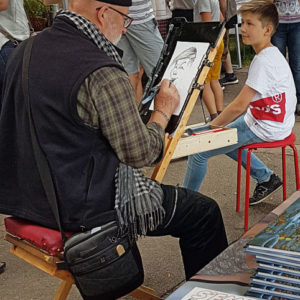 Champol caricaturiste au chevalet